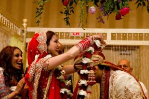 Bride exchanging Varmala with the Groom in a wedding ceremony organized by Event Management company named Kiyoh